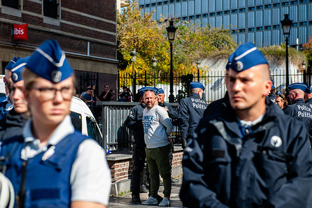 A man from an extreme far-right group is seen being arrested by the riot police during the demonstration. Since the Vlaams Belang (VB) a right-wing populist, Flemish nationalist political party achieved the second-highest vote in Flanders in the May regional elections, and also was excluded from the negotiations still taking place to form a new regional government. The extremist group 'Bloed, Bodem, Eer en Trouw' (BBET, Blood, Soil, Honour, and Loyalty) organized a protest against the exclusion of Vlaams Belang from talks on the new Flemish government. Around thirty supporters trying to gather at the Place d'Espagne in the center of Brussels, but they were stopped by the riot police and were put under arrest.