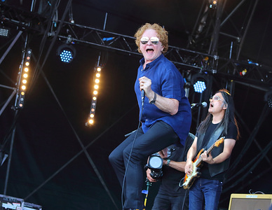 Mick Hucknall of Simply Red Pop band performs live on stage at the BBC Radio 2 Live in Hyde Park, London.