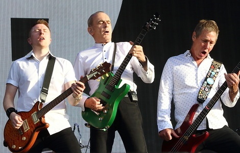 Richie Malone, Francis Rossi and John 'Rhino' Edwards of Status Quo English Rock band perform live on stage at the BBC Radio 2 Live in Hyde Park, London.