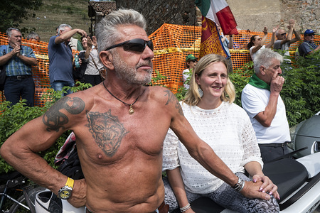 A topless man looks on during the event. The annual meeting of the populist italian party 'The League' has a particular resonance as anti-government stances rises among supporters since the Italian government faces several political crisis as well as the loss of the role of The League's leader, Matteo Salvini as Ministry of Interior.