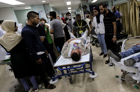 (EDITORS NOTE: Image contains graphic content.)  A Palestinian man role-playing an injured person takes part in a drill for treating mass casualties, at a hospital in the southern Gaza Strip. A medical exercise conducted by the Palestinian Ministry of Health to examine the readiness of medical staff in case of emergency in all hospitals.
