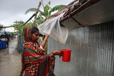 A woman collects rainwater by using a plastic sheet under tin roof, rainwater is the main source of drinking water at the Shyamnagar villages. Bangladesh is one of the countries most vulnerable to the effects of climate change. The regular and severe natural hazards that Bangladesh already suffers from tropical cyclones, river erosion, flood, landslides and drought are all set to increase in intensity and frequency as a result of climate change.