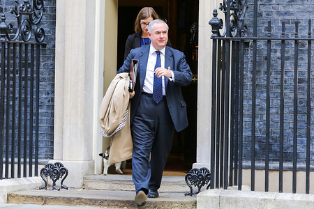 Attorney General Geoffrey Cox is seen leaving No 10 Downing Street after attending the weekly cabinet meeting.