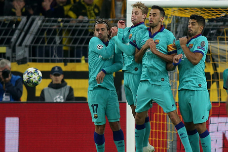 Players of FC Barcelona jump in a wall to defend a free kick during the UEFA Champions League match between Borussia Dortmund and FC Barcelona at the Signal Iduna Park in Dortmund. (Final score; Borussia Dortmund 0:0 FC Barcelona)