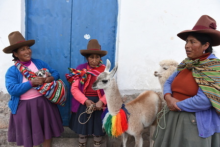 Women are seen with a vicuña (L) and an alpaca on the street at the San Blas neighbourhood. Cusco is a city in southeastern Peru, near the Urubamba Valley of the Andes mountain range. It has a population around 430.000 and was declared a World Heritage Site by UNESCO in 1983.