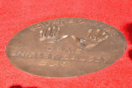 Handprints of Dame Shirley Bassey in the form of a bronze plaque in the 'Square of Fame' at The SSE Arena, Wembley, in Wembley Park in London, to mark 60 years of entertainment at London's iconic music and entertainment venue.