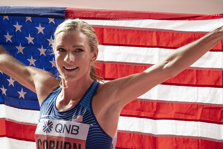 Emma Coburn of the USA celebrating her second place in the women's 3000m steeplechase final on day four of 17th IAAF World Athletics Championships at Khalifa International Stadium.