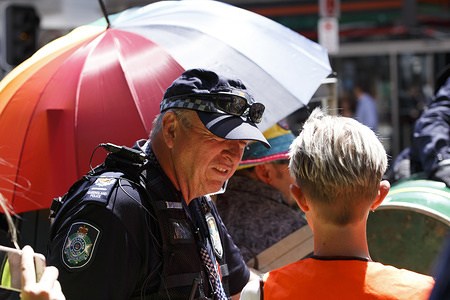 A Queensland Police officer speaks with an Extinction Rebellion representative on George Street during the protest. Climate change activism group Extinction Rebellion have amassed members in around seventy countries, and during their 'Rebellion Week' they planned to cause continued disruption to business and roads as a means to force government policy change when it comes to environmental and climate change issues. On this second day of the Rebellion Week, numerous individuals sought to cause disruptions in the Brisbane Central Business District.