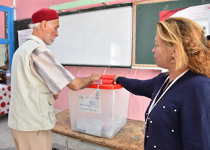 Tunisians voters cast their ballot at a polling station during the second round of the presidential election. Voters will choose between law professor Kais Saied and business tycoon Nabil Karoui, both political outsiders who gained most votes in the first round of the polls last month.