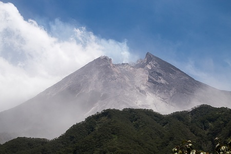 View of Mount Merapi with smoke from Bukit Klangon, Cangkringan. Based on information from the Institute for Investigation and Development of Geological Disaster Technology (BPPTKG), the level of activity of Merapi is still on alert or Level 2, Residents are advised to remain calm and not be active within a radius of less than 3 kilometers from the mountain peak.