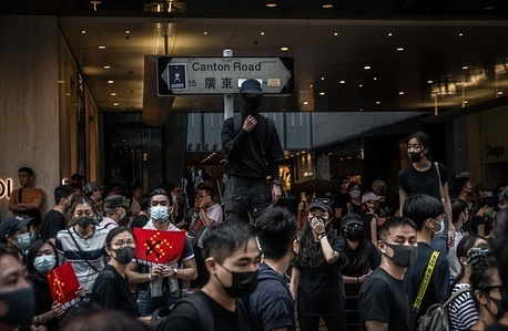 Protesters wearing masks gather at Canton Road during the anti-government march. Protesters defy demonstration ban, anti-mask law in Hong Kong and continue to protest across Hong Kong for the 20th consecutive week. After marching for few hours from Tsim Sha Tsui towards the speed train rail station, clashes between protesters and riot police occurred in different parts of Kowloon side.