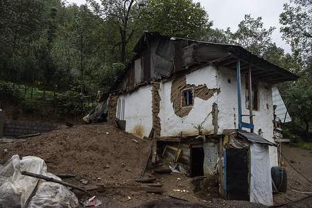 A destroyed house by landslides caused by floods. Heavy rains caused landslides and floods in the Shaft city. Several bridges collapsed and roads of the three hundred households of the village of Visrood were blocked. The flood also damaged homes and farms. Shaft is a city in the west of Guilan province.
