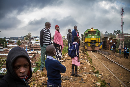 Residents wait to board the morning passengers train at a normal train stop in Kibera. Inside Africa's largest Slums of Kibera lives a population of about one million Kenyan Citizens. It's a hideout to the rising population of the poor who are looking for a cheap and sustainable life. The rate of crime and teenage pregnancies among others is high due to unemployment. As all poor communities, people here mostly believe in togetherness and happiness despite of all the challenges.