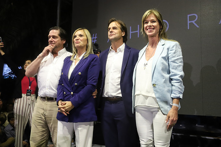 Luis Lacalle Pou, presidential candidate for the National Party and Beatriz Argimon vice presidential candidate  (Left) are seen before the elections. The National party and the Frente Amplio party will go to second round on November 27 after obtaining most of the citizen's votes.