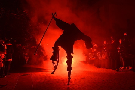 A man walking on stilts takes part during the festival. Villagers of Almazan gathered on the streets to honour and remember the witches, who inhabited this Spanish province. Witches, who were mostly healers and midwives, cured diseases with their spells, potions or simply their good work. Many of them ended up being executed.