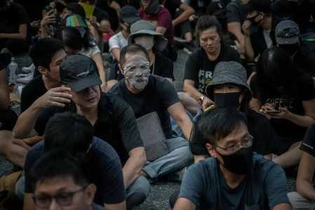 """Protesters sit at the Charter Garden as they take part during the demonstration. Hong Kong protesters demonstrate for 22nd consecutive weekend in Central district of Hong Kong. Protesters continue to call for Hong Kong's Chief Executive Carrie Lam to meet their remaining demands since the controversial extradition bill was withdrawn, which includes an independent inquiry into police brutality, the retraction of the word """"riot"""" to describe the rallies, and genuine universal suffrage."""