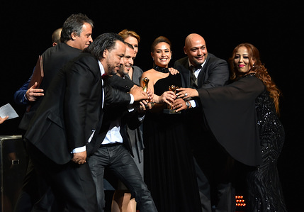 """Tunisian film writer and Producer Hinde Boujemaa (4thR) and her staff pose with the gold tanit for her film """"Noura Reve"""" during the closing ceremony of the 30th edition of the Carthage Film Festival in Tunis."""