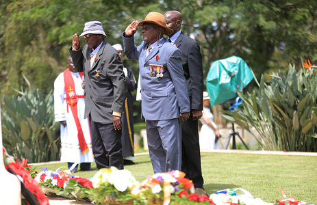 World War Veterans, Mutemi Nwinza (left) laying wreaths with his counterpart, Samuel Nyahure (Right) of 11th Battalion during the commemoration ceremony of World War Veterans held at the Commonwealth War Graves Cemetery that was opened in 1941 by the military authorities. It contains 1,952 Commonwealth burials of the Second World War, 11 of which are unidentified. Nairobi was the headquarters of the East African Force.