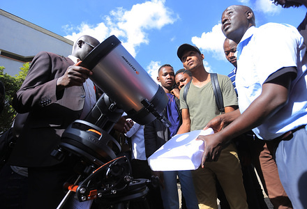 Department of Astronomy and Space Science Researchers and students at the Technical University of Kenya observe Planet Mercury using an 8-inch digital Celestron telescope as it transits face of the sun and the Earth disc, this phenomenon witnessed largely in African Zone on November 11, 2019 last happened in 2016 and will happen again in 2032.  The spectacular event was visible from all parts of Africa from around 1 pm to 5 pm. Direct observation with naked eye is dangerous and therefore light concentration was beamed on a white surface to observe planet Mercury's motion.