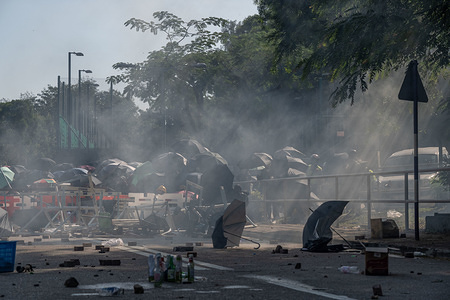 Tear gas being fired at protesters during the demonstration. A general strike organised by protesters turned into clashes and conflicts, the riot police tries to secure the second bridge in the Chinese University of Hong Kong.