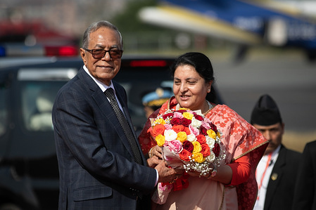 President of Bangladesh, Abdul Hamid (R) receives a bouquet of flowers from Nepal's President, Bidhya Devi Bhandari (L) upon his arrival at Tribhuvan International Airport. President of Bangladesh is on a three-day official goodwill visit to Nepal at the invitation of Nepal's President.