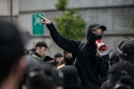 A protesters speaks on a megaphone while addressing the assembly at City University of Hong Kong during the demonstration. Protesters called for a day of strike and commuters faced chaos and delays across Hong Kong for the second consecutive day as anti-government protesters blocked roads, train rails and subway accesses on a call for strike. Unrest broke out at three universities and many schools and businesses were closed. Violence returned in a response to police actions on Monday when at least two protesters were shot and many others wounded.