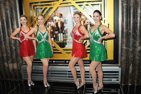 The Radio City Rockettes Light The Empire State Building in New York City.