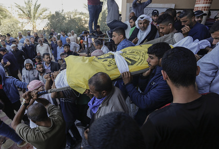 (EDITOR'S NOTE: Image depicts death) Palestinian Mourners carry the bodies of the deceased during their funeral in central Gaza Strip. Rasmi Abu Malhous and seven members of his family were killed in an overnight Israeli missile strike that targeted their house. The death toll from Israeli strikes targeting Islamic Jihad fighters has risen to 32 since November 12, while 350 rockets have been fired into Israel, according to an Israeli military base.