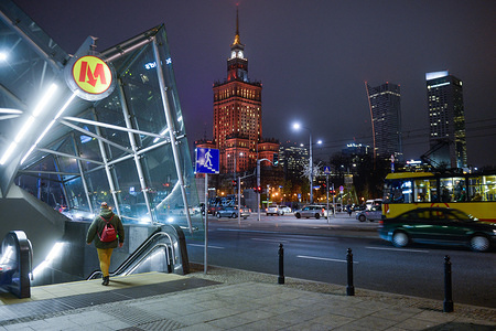 A man enters a metro station close to the Palace of Culture and Science.
