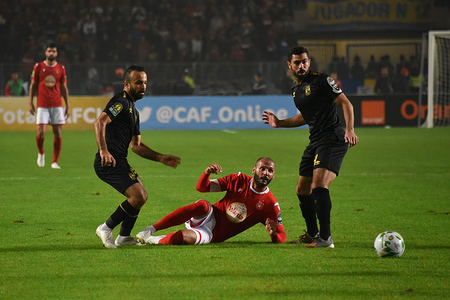 Ahly's Ahmed Fathi and Etoile's Yassin Chikhaoui in action during the CAF Champions League 2019 - 20 football match between Al-Ahly and Etoile sportive du sahel in Rades. (Final score: Etoile du Sahel 1 – 0 Al Ahly)