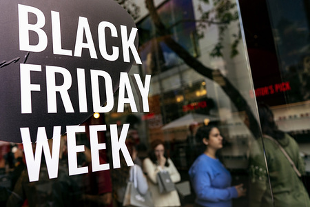 LOS ANGELES, UNITED STATES, NOVEMBER 29, 2019: Shoppers walk past a Black Friday sign in Los Angeles. Black Friday occurs the day after Thanksgiving and that marks the beginning of the holiday shopping season, as retailers lure shoppers with reduced prices.
