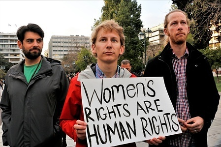 Male participants seen joining the march with placards. Democrats abroad demonstrate in Athens as part of the Women's March 2018 in support of women, lesbians gay bisexual transgender, the climate change, and refugees rights. They condemned the policies of American president Donald Trump