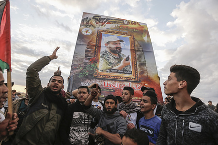 Palestinian demonstrators carry a photo of the martyr Baha Abu Al-Atta during the demonstration. Palestinians clashes with Israeli security forces demanding for an end to the Israeli blockade of Gaza and the right of return to their homeland at the border fence between Israel and Gaza in the southern Gaza Strip.