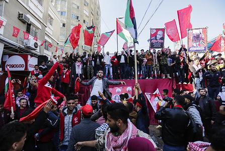 Crowd of Palestinians with flags during the rally. The Popular Front for the Liberation of Palestine (PFLP) holds a rally to mark the 52nd anniversary of the group's founding in Gaza City.