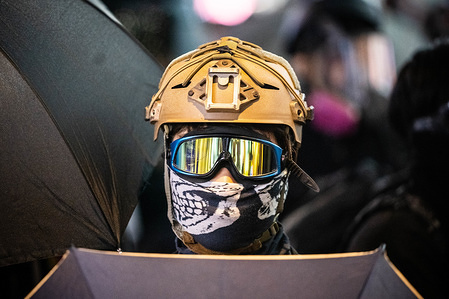 A protesters wears a helmet and protection goggles at the front line during the demonstration.  Hundreds of thousands of people marched through Hong Kong to mark Human Rights Day and press for greater democracy in the city.