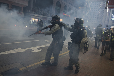 Police fire tear gas toward protesters during the demonstrations. Despite the controversial extradition bill which originally sparked the protests being formally withdrawn, protesters continue to call on Chief Executive Carrie Lam to meet their remaining demands, which includes complete universal suffrage, an independent investigation into police brutality, retraction of the word 'rioting' to describe the protests, and dropping all charges against arrested protesters.
