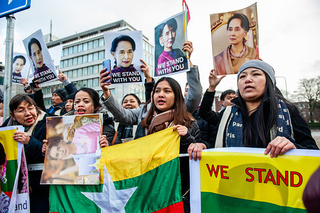 Female supporters of Aung San Suu Kyi hold placards while shouting slogans during the demonstration. Aung San Suu Kyi is scheduled to lead a delegation to the International Court of Justice (ICJ) to defend Myanmar against accusations of genocide for two days. Outside of the ICJ building tension was high, since hundreds of supporters of Aung San Suu Kyi from different countries gathered to receive and show their support to the Myanma state counsellor. But also hundreds of people from The European Rohingya Council (ERC) and Myanmar Muslim Association Netherlands (MMAN) organized a rally in front of the ICJ to seek justice for the persecuted Rohingya community.