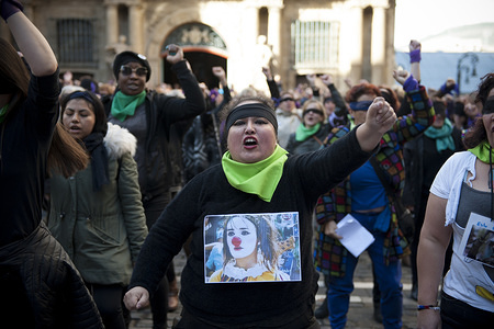 Women performing during the protest. Demonstration for women's rights with a performance in repudiation of the events that took place in Chile that involved the abuse of women by the Chilean Government.