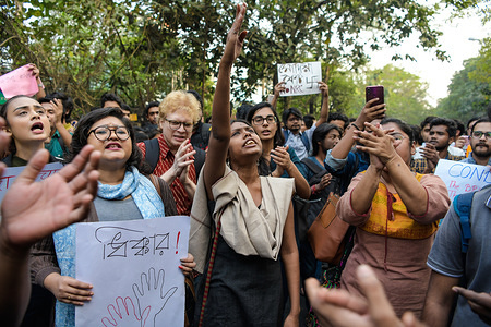 Students of Jadavpur University chant slogans during the demonstration against the citizenship amendment Act and also condemning the brutal state atrocity in Jamia Milia Islamia University.