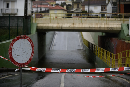 """Closed road to the passage tunnel flooded with water due to heavy rainfall. Winds with gusts ranging from 95 km/h and waves between 4 and 7 meters are expected as """"Elsa Storm"""" passes by North of Portugal."""