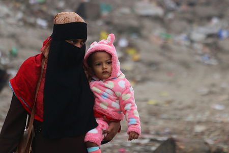 A mother and child walk on the street during a cold wave in Dhaka. The country's lowest temperature on Thursday were recorded at 7.9 degrees Celsius in Chuadanga, according to the Met Office. At the same time the lowest temperature in Dhaka were recorded at 13.2 degrees Celsius.