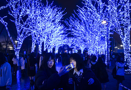 People take part in the Christmas theme  'Blue Cave' illumination event in at Yoyogi Park, Shibuya. The illumination event with 600,000 light bulbs will be displayed until December 31