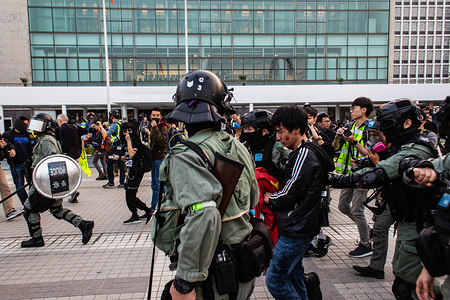 Riot policemen arrest a protester during the demonstration. 6th month of civil unrest, protesters attend a rally in solidarity with Uyghurs in Xinjiang. Speeches were given by event organisers. Riot Policemen appeared and were confronted by masked demonstrators.