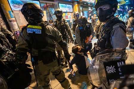 Police officers arresting a protester during the unrest. Anti-government protesters rallying on Christmas Eve in Hong Kong continue their demands for an independent inquiry into police brutality.
