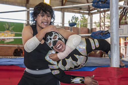 """wrestlers in action during the Show in El Alto. Wrestling show in El Alto by women in traditional costumes known as """"Cholitas"""" derogatory phrase against Bolivian women who with this show seeks to revalue the identity and important role of women in society demonstrating that they can fight the same and even Better than boys."""