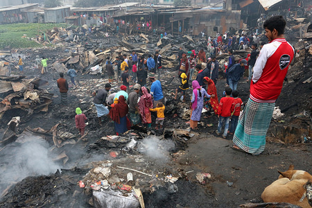 Dwellers at the fire devastated slum in Baunia badh area of Kalshi at Dhaka's Mirpur. A fire gutted over 100 shanties at a slum in Baunia badh area of Kalshi at Dhaka's Mirpur.