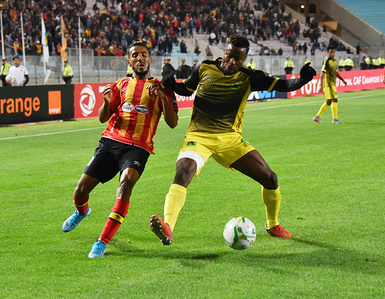 Esperanc's Players Hamdou El Houuni and AS V Club player Ernest Luzolo Sita are seen in action during the CAF Champions League 2019 - 20 football match between Esperance sportive tunisia and AS.V.Club congo in Rades.  (Final score; Esperance sportive 0: 0 AS v.Club)