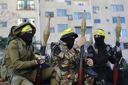 Palestinian gunmen from the Al-Aqsa Martyrs Brigades during the 55th anniversary of the Fatah movement founding in Gaza City.