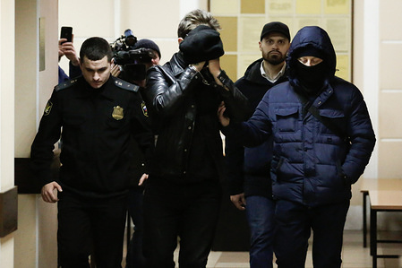 Georgy Chernyshev (C) suspected for plotting a Christmas terrorist attack brought for a closed-door detention hearing at Dzerzhinsky District Court. Vladimir Putin thanked Donald Trump for a tip that foiled Russian terror plot.