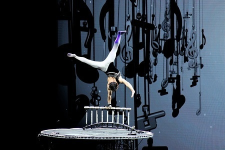 A Chinese Acrobat performs on a contemporary spinning table during the event. The Chinese national acrobatic troupe gave an excellent and majestic performance at Christmas theatre in Galatsi Olympic stadium.
